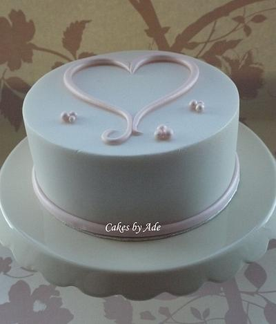 Simple lustre pink & white heart cake - February 2012 - Cake by Cakes by Ade