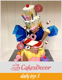 Topsy turvy candyland themed cake