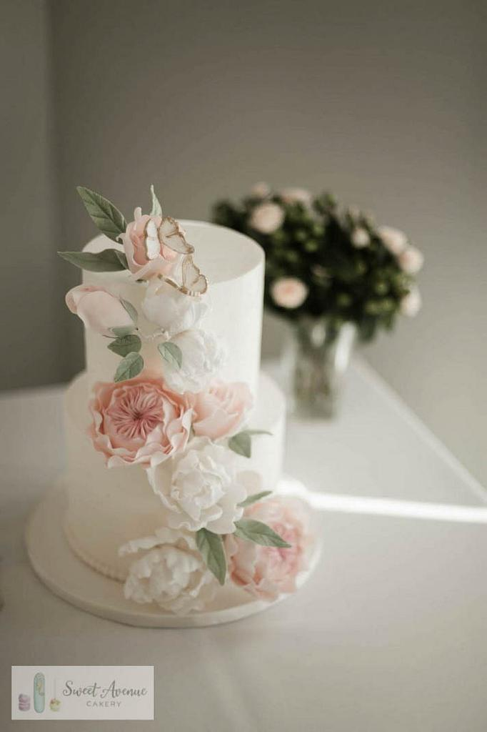 Romantic floral cascade wedding cake by Sweet Avenue Cakery
