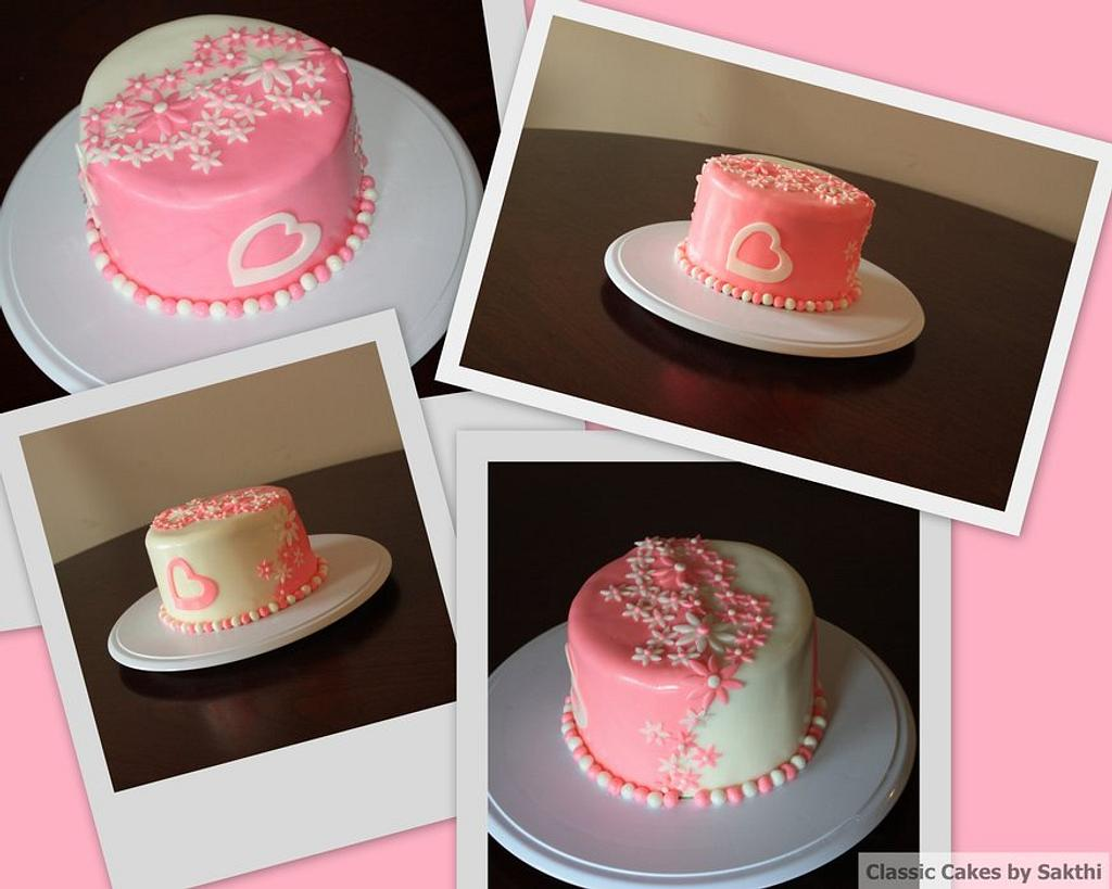 Pink and white double color cake by Classic Cakes by Sakthi