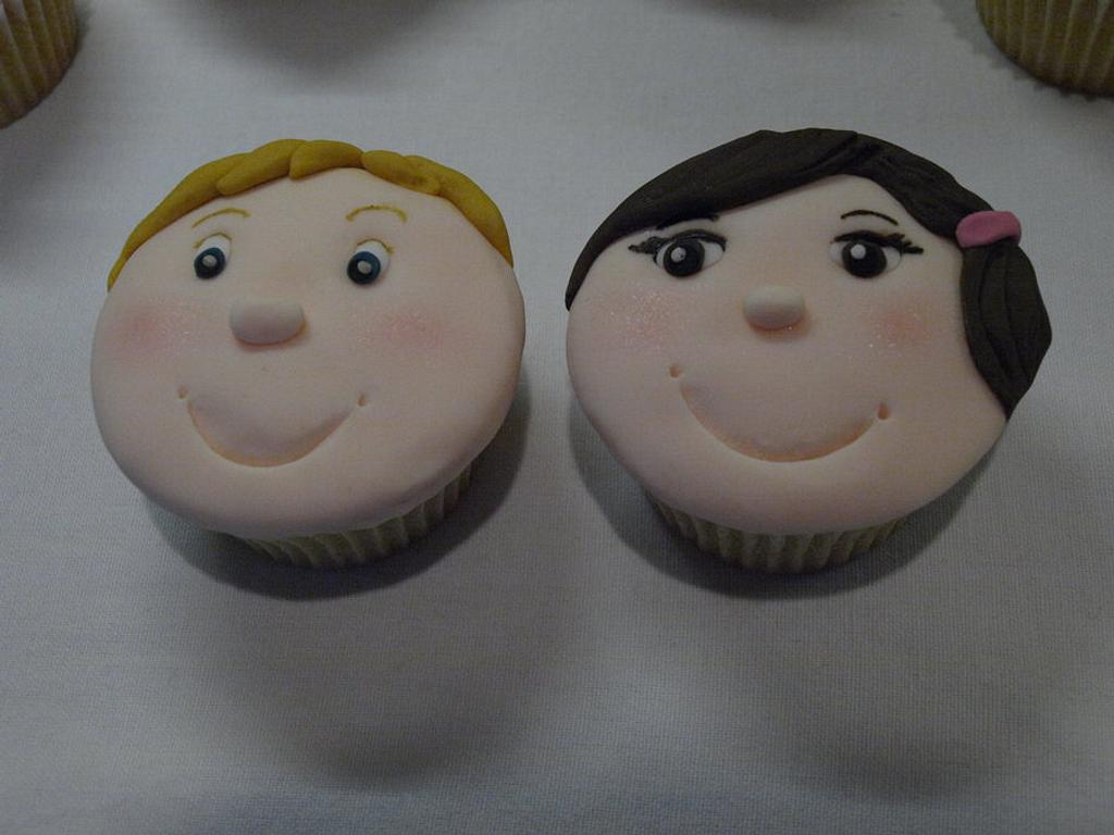Boy and Girl face cupcakes  by Kaylee
