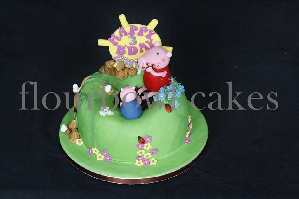 Peppa pig and George playing in a pool of mud and cupcakes by Flourbowl Cakes
