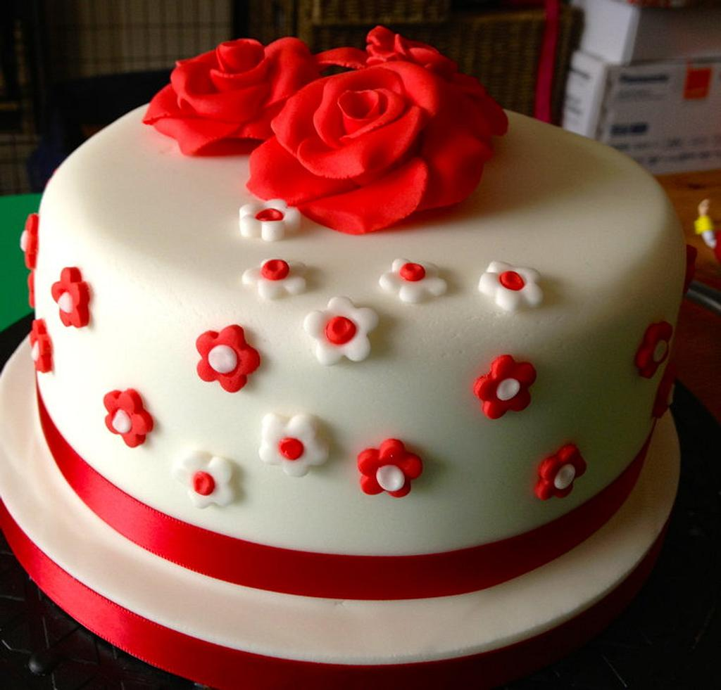 Simple rose topped cake by Kelly