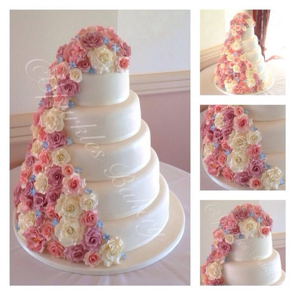5 tier wedding cake with cascading flowers by Karen