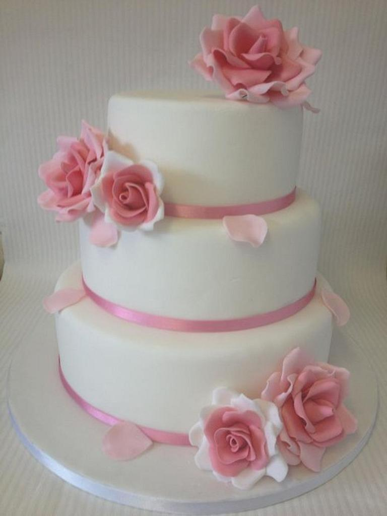 Large pink roeses wedding cake by Laura Woodall
