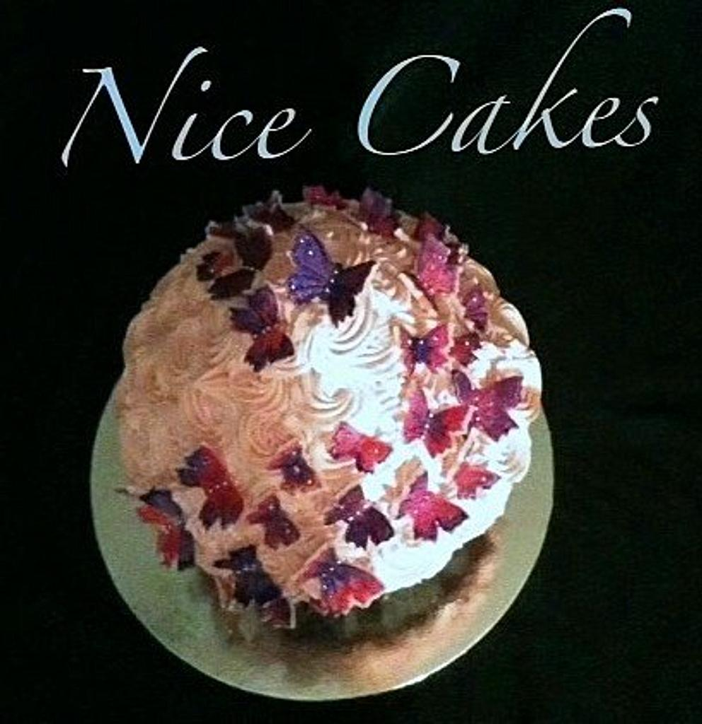 Giant cupcake with handpainted fondant butterflies by Hope