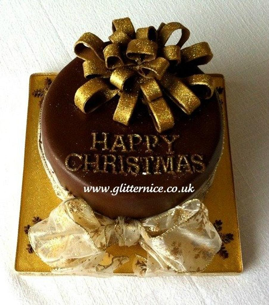 Chocolate Christmas Cake with gold ribbons by Alli Dockree