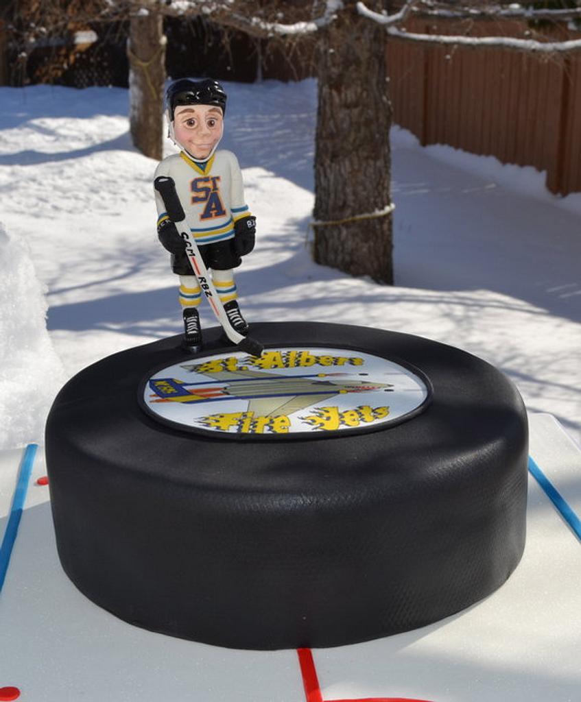 Hockey puck cake by Carol