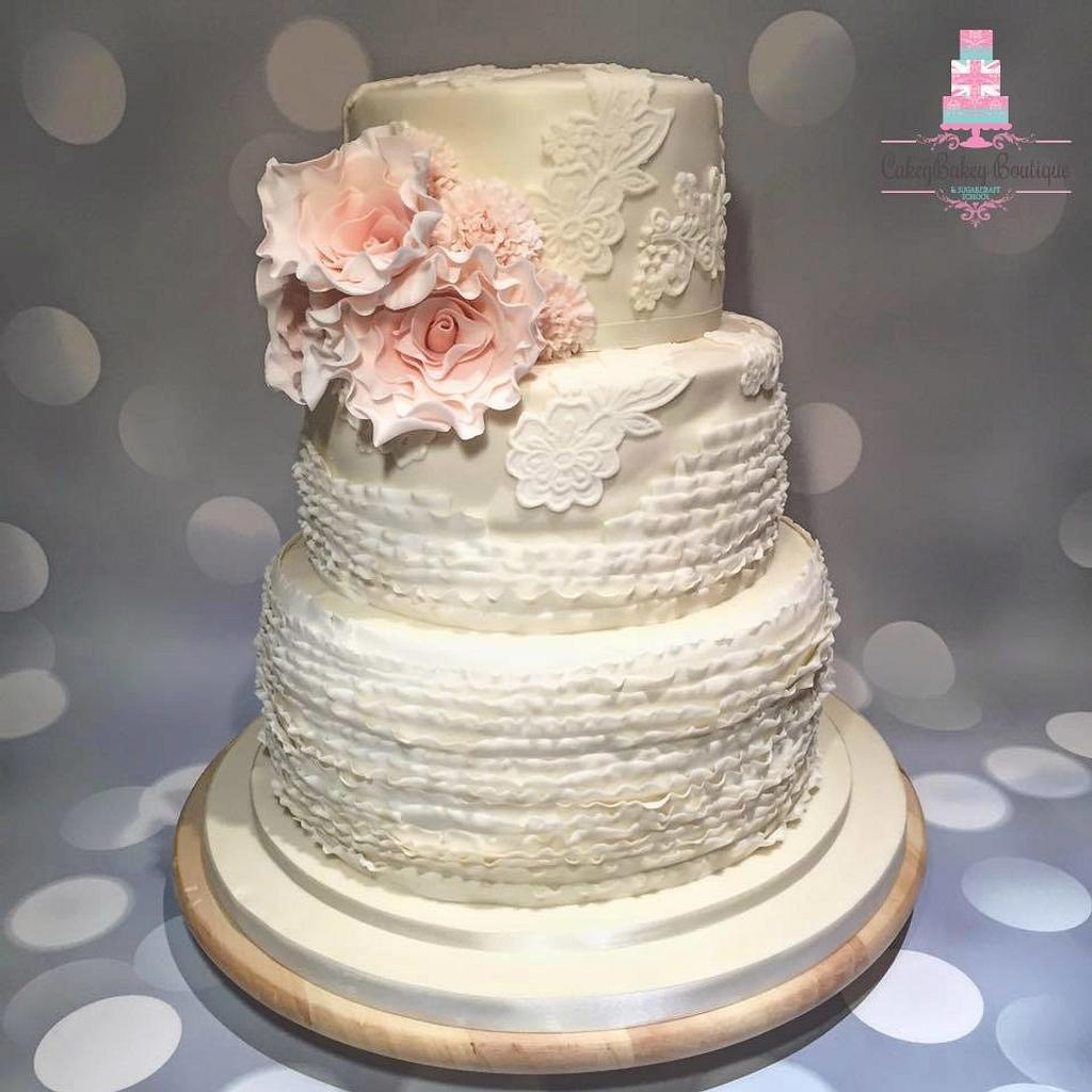 Ruffle and Lace wedding cake with blush pink ruffle roses by CakeyBakey Boutique