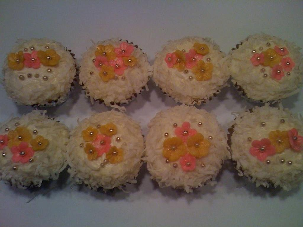 COCONUT CUPCAKES by pink sugar frosting