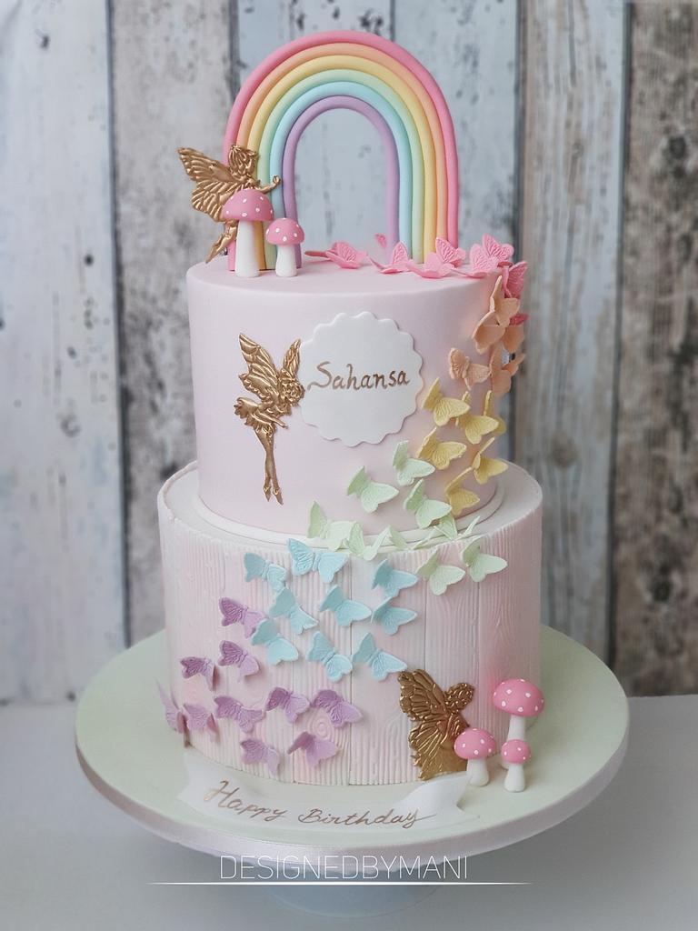 Pastel Rainbow butterfly cakehttps://www.designedbymani.com/ by designed by mani