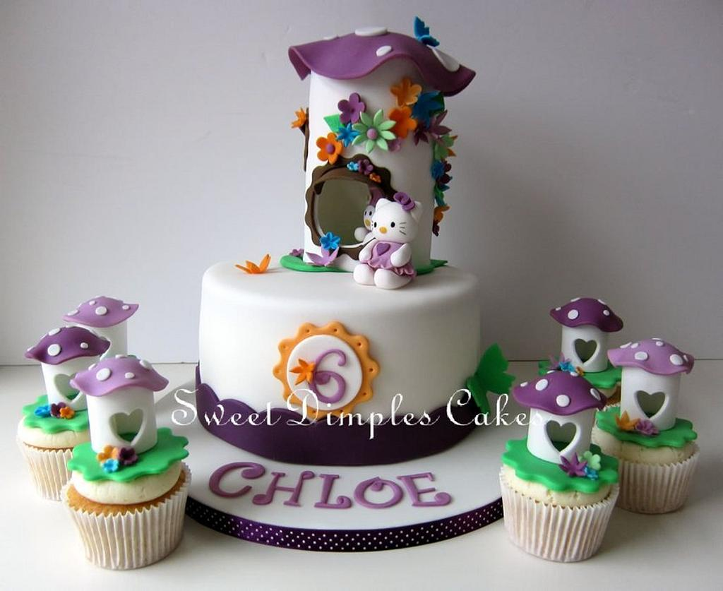 Hello Kitty Themed cake and cupcakes by SweetDimplesCakes