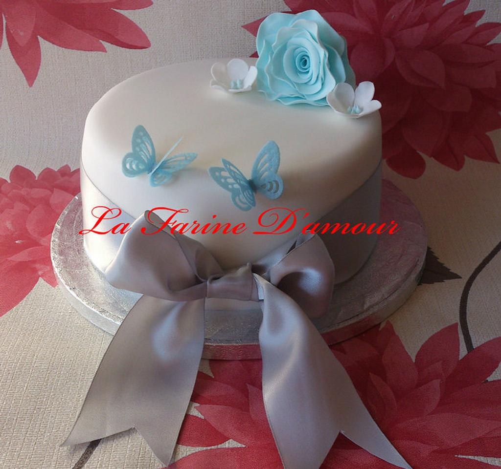 Birthday Cake - white with blue and white flowers by Lucy's Cakes and Bakes