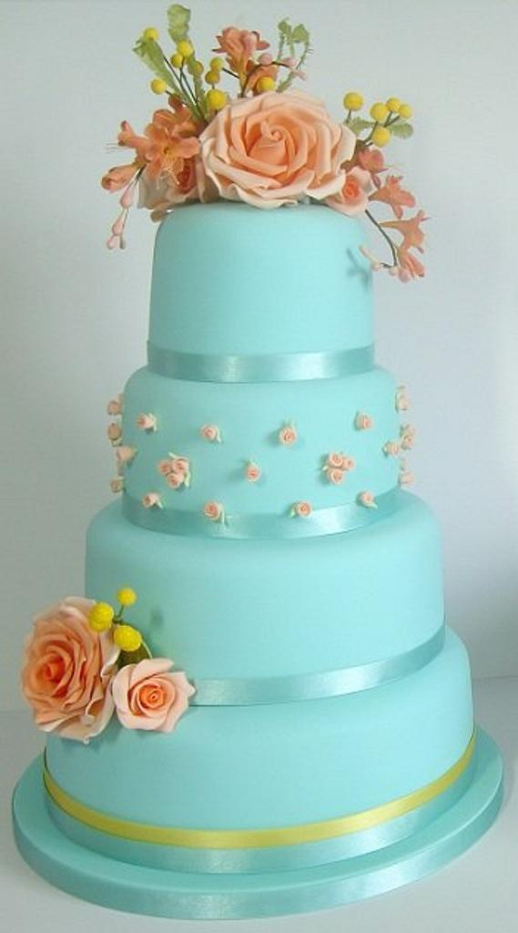 Blue cake with orange roses and freesias, and mimosas by ClearlyCake