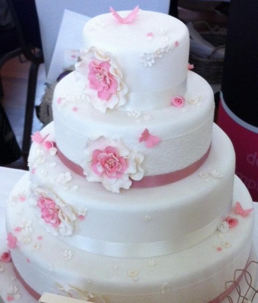 Pretty in pink wedding cake by dazzleliciouscakes