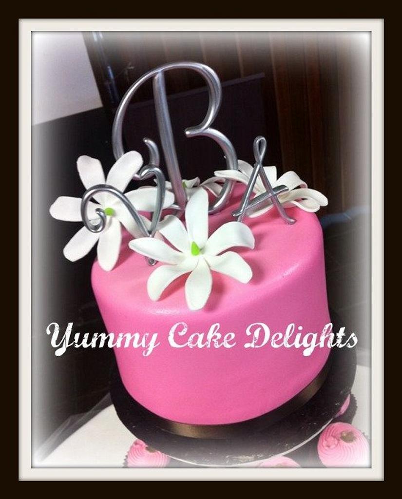 Wedding cake with handmade edible Tiare flowers by Kathryn