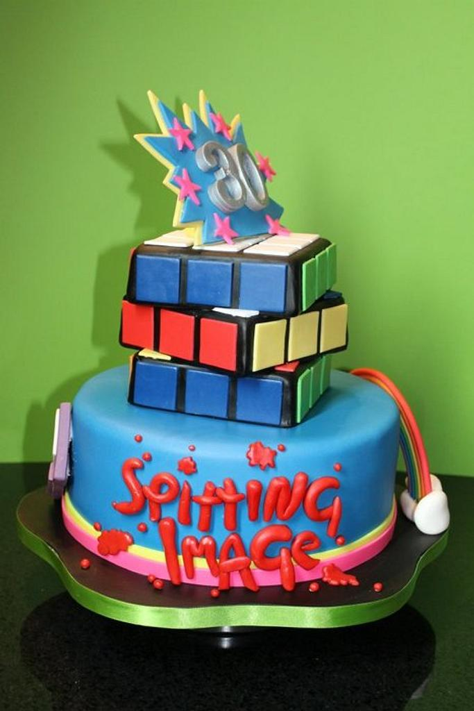 80's themed tiered cake. by Delights by Design
