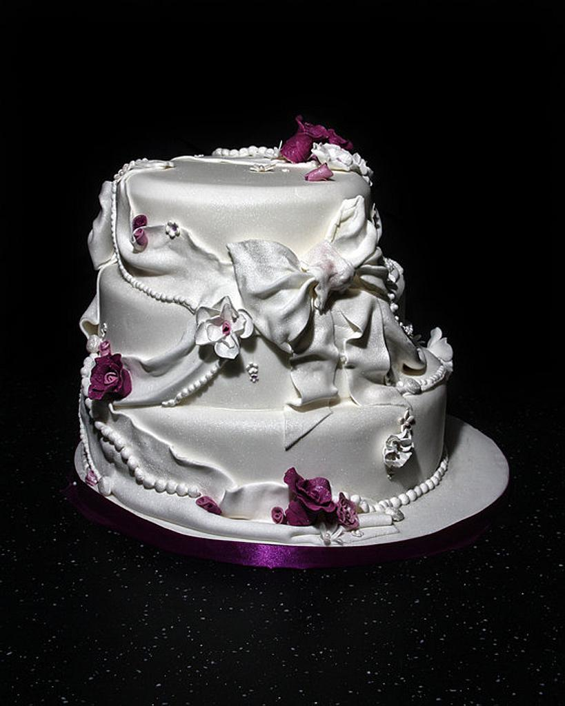 Dazzlelicious Bow, fabric and flowered wedding cake by dazzleliciouscakes