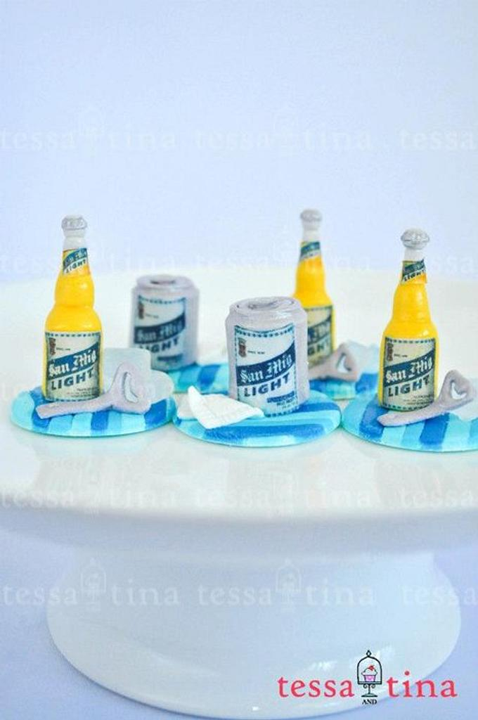 San Mig Light cupcake toppers by tessatinacakes