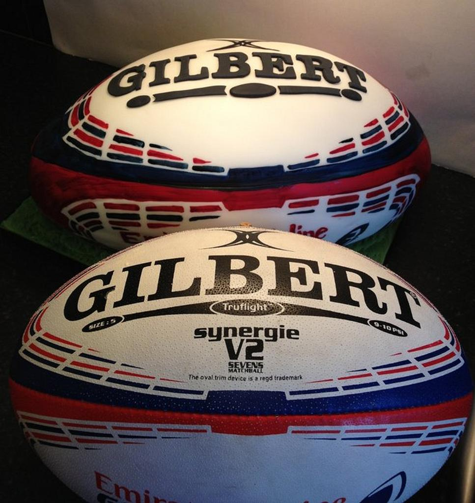 Hand painted rugby ball cake by Loz