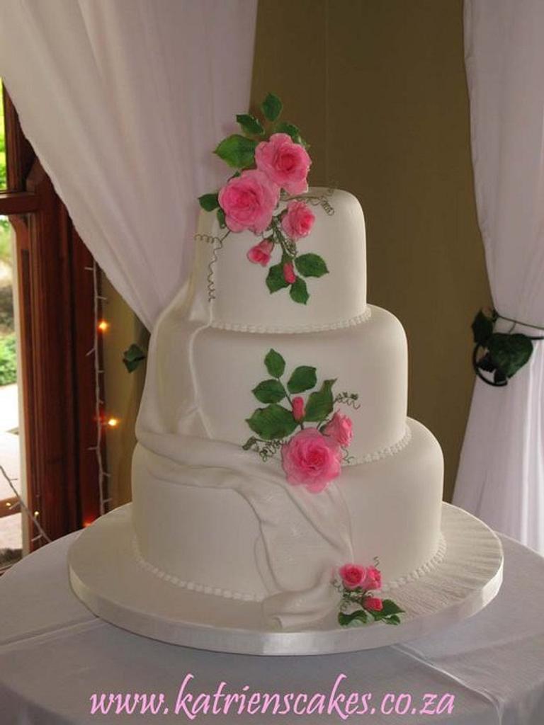 Fondant Drapes and Pink Sugar Roses by KatriensCakes