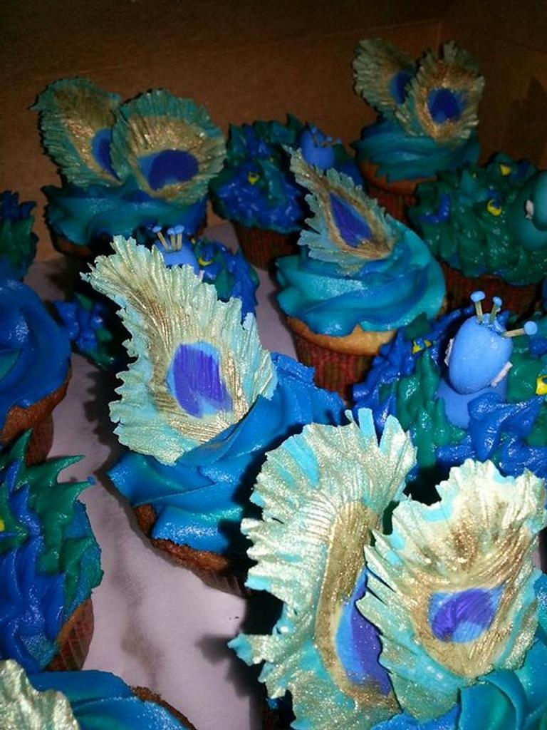 Peacock feather cupcakes  by Kassie Smith