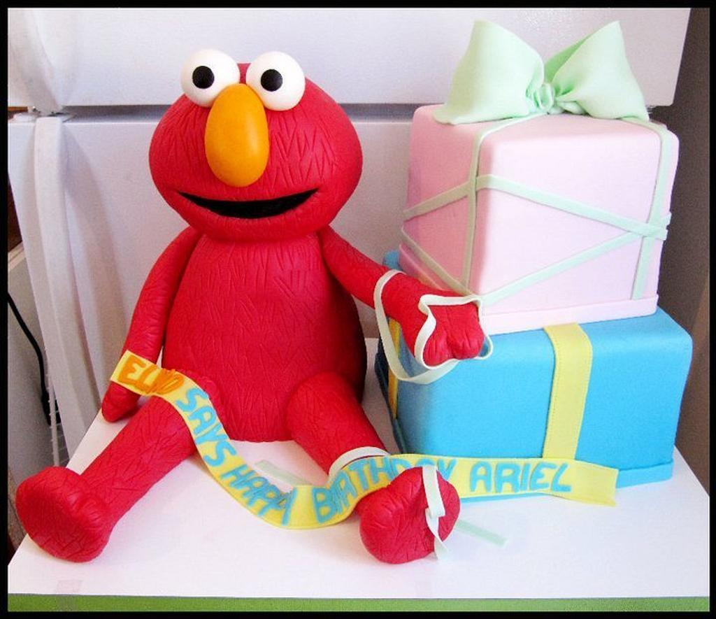Elmo and presents  by Kasey