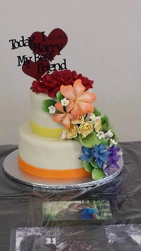 Wedding cake with floral rainbow effect by m1bame
