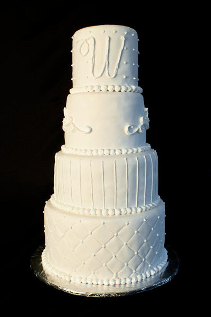 White Four Tiered Wedding Cake by Jenn