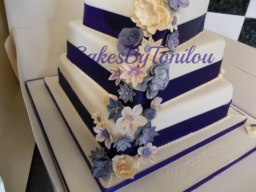 Cadburys purple wedding cake by CakesByTonilou