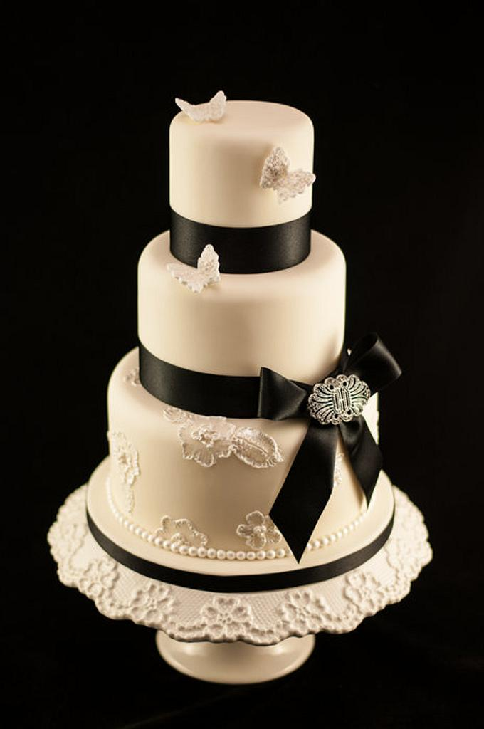 Brush embroidery, butterfly, black bow and brooch wedding cake by Kathryn