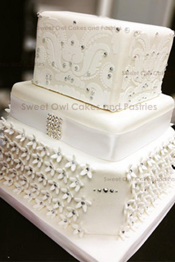 white wedding cake by Sweet Owl Cake and Pastry