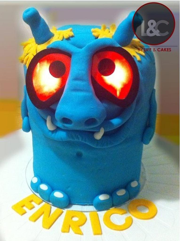 Blue Monster with shining eyes by Laura