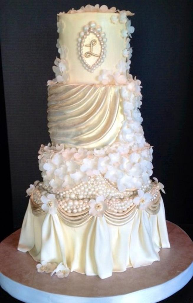 White, Ivory, and Champagne Pearls and Swags Wedding cake by The Vagabond Baker