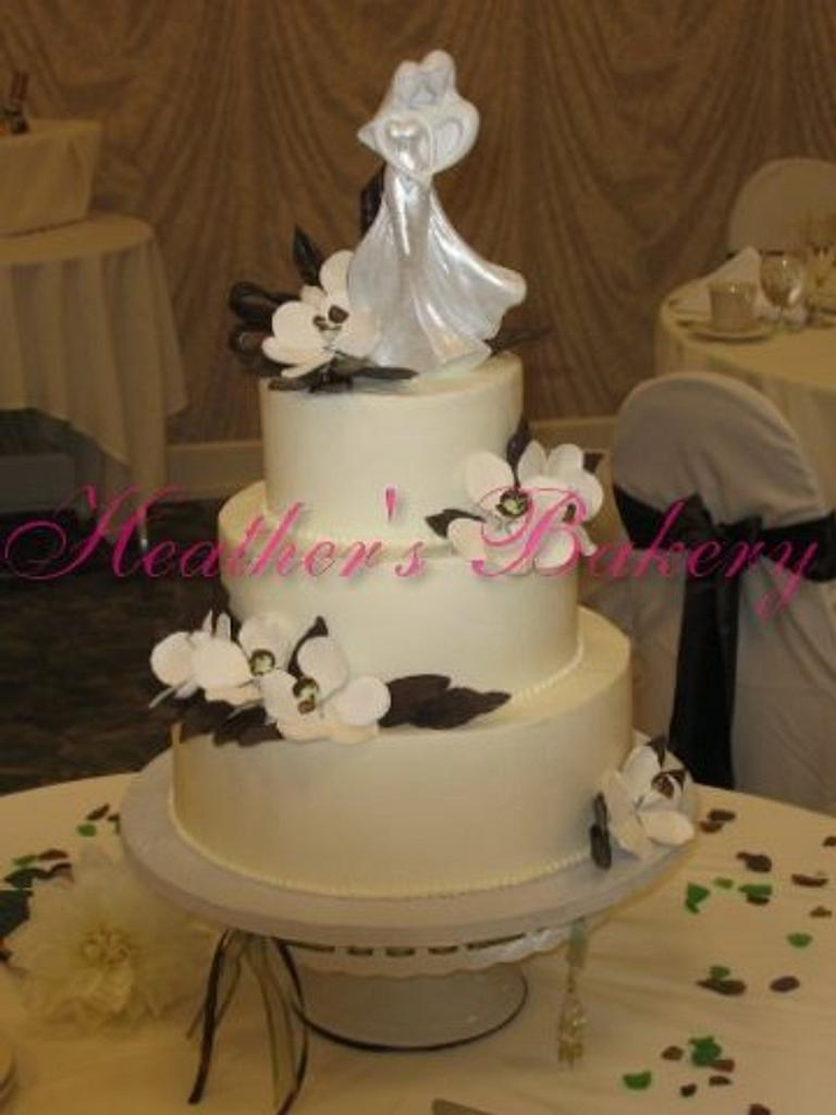 Buttercream with Gumpaste Flowers and Chocolate Leaves and Ribbon by HeathersBakery
