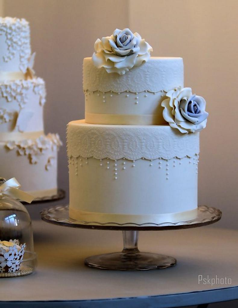 Double barrel white vintage lace cake by Bella's Bakery
