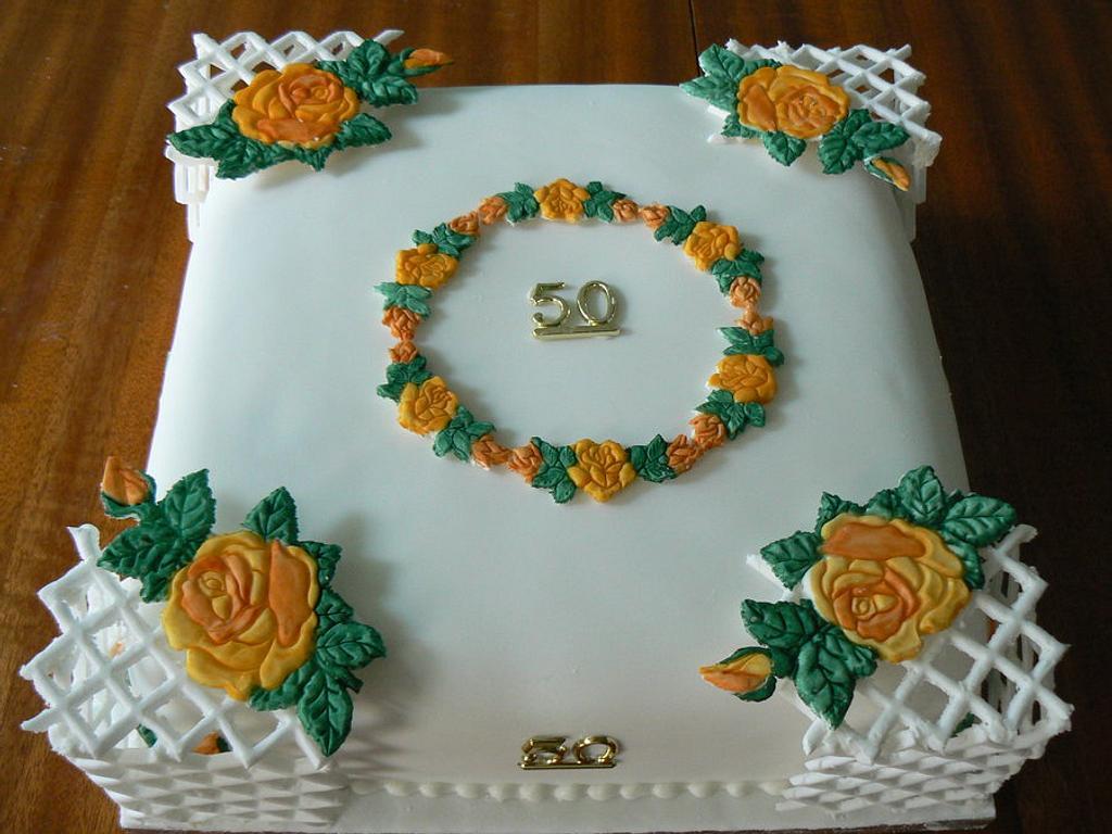 Golden wedding cake with trellis. by Anita's Cakes