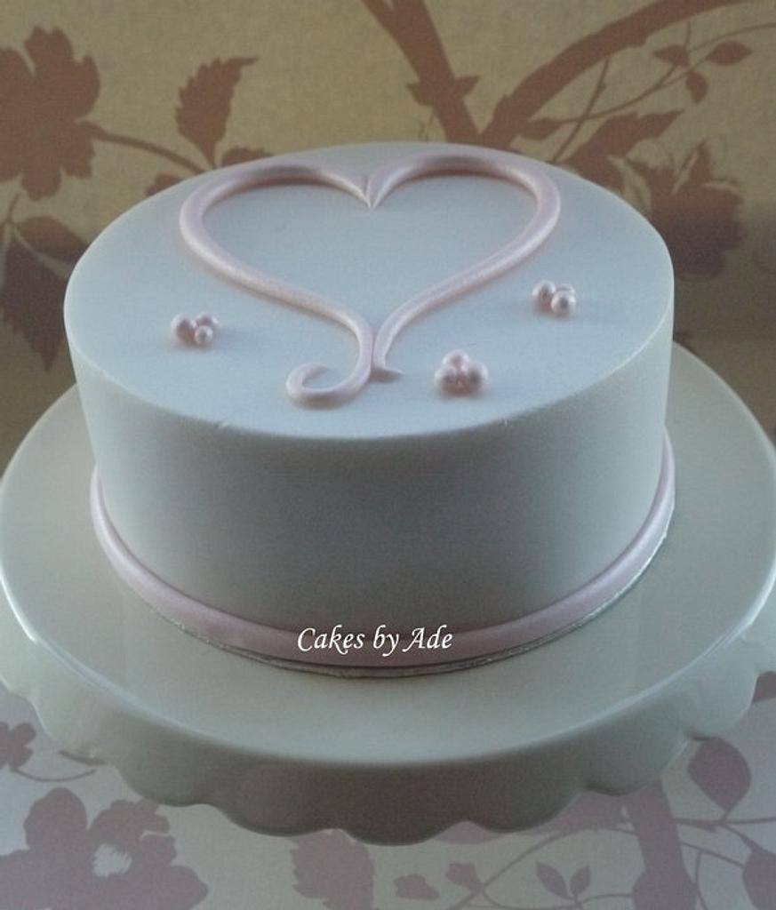 Simple lustre pink & white heart cake - February 2012 by Cakes by Ade