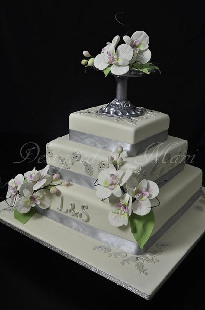 wedding cake with moth orchids by designed by mani