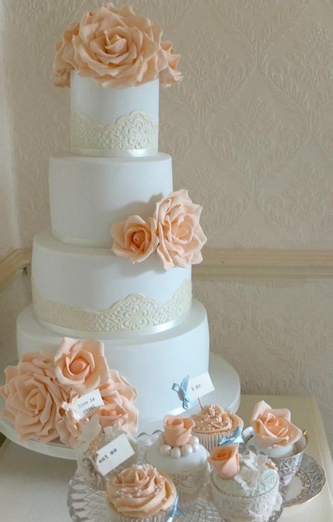 Duck egg and peach wedding cake by Paula