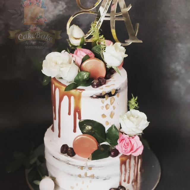 Rustic looking wedding cake in whipped cream