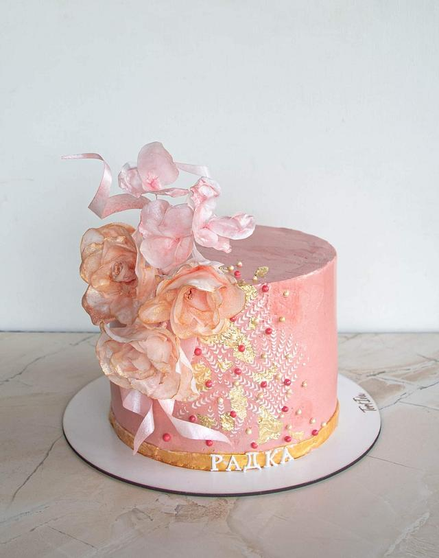 Pink gold cake with fantasy flowers