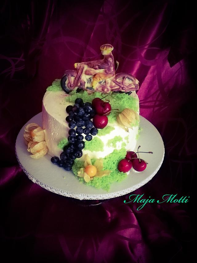 Fruit's cake with chocolate motorcykle