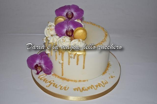 Gold drip cake with orchids