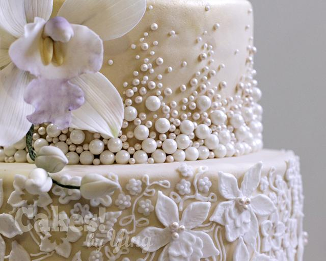 Classy 80th pearls, lace and orchids