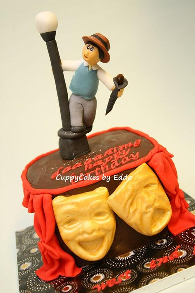 """west end """"singing in the rain"""" inspired cake"""