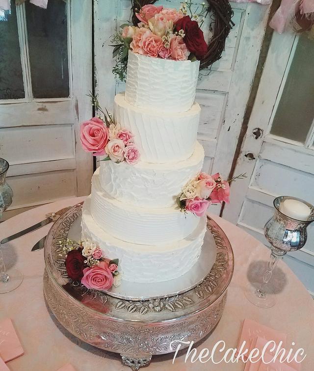 Romantic buttercream wedding cake