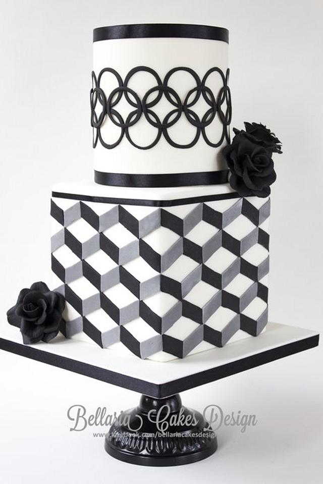 Modern black and white bridalshower cake with geometric patterns.