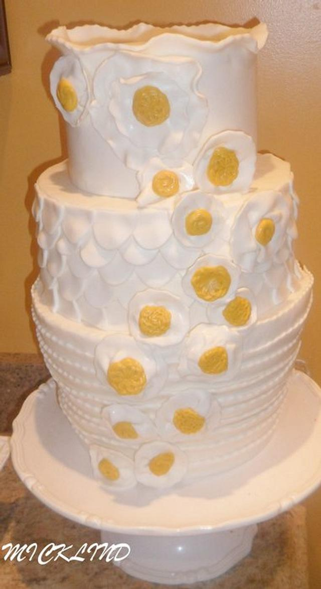 A WHITE AND MUSTARD WEDDING CAKE