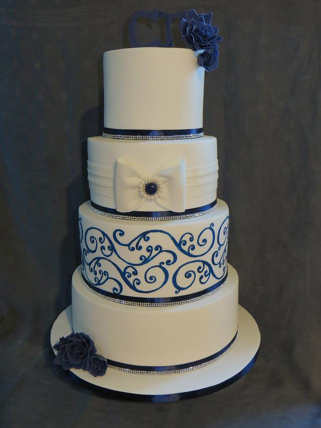 Hand painted bow and brooch cake